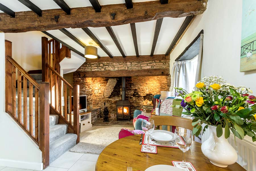 beautiful cottage table and woodburner