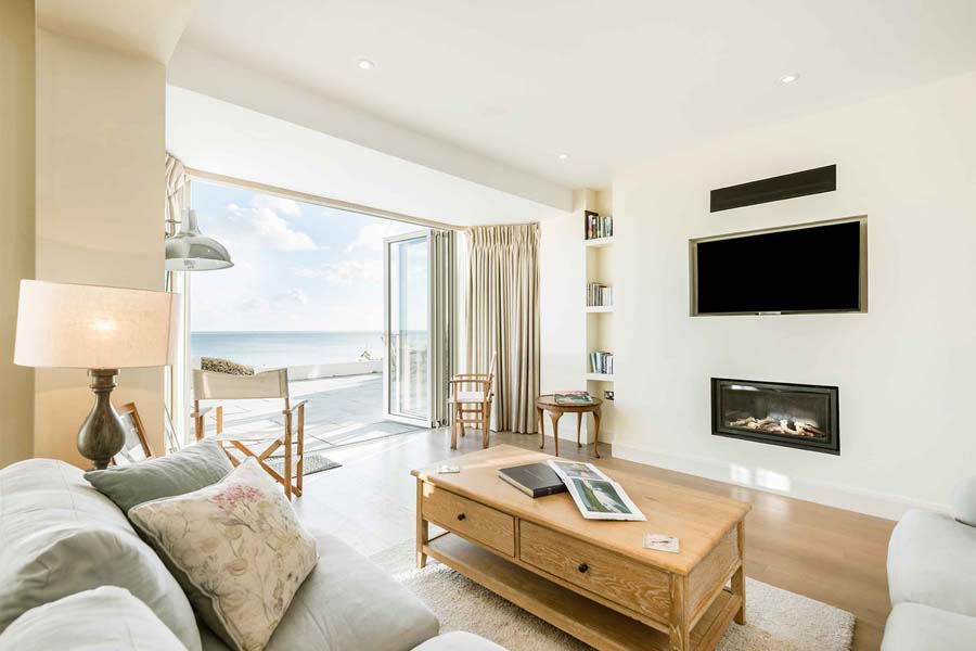 coffee table and sofas with views onto sea