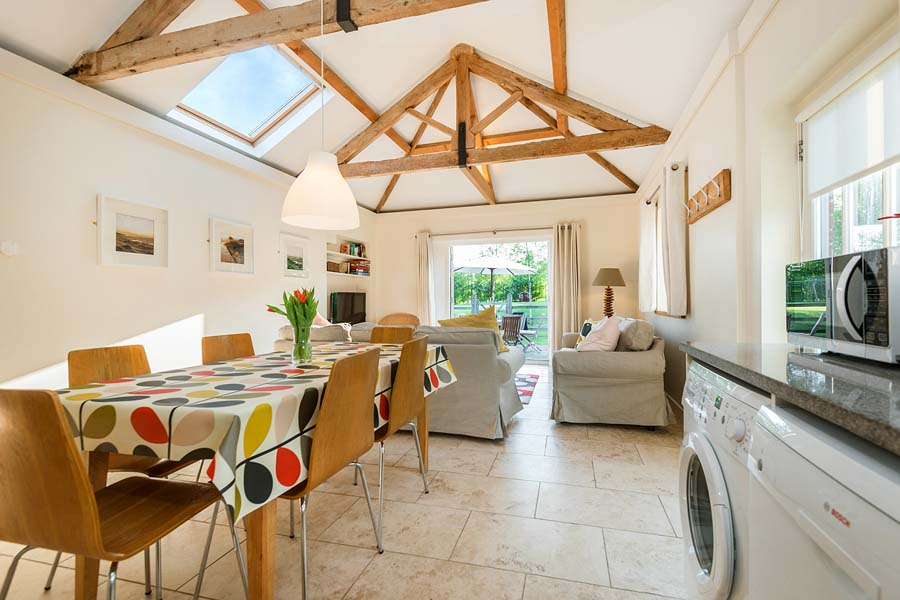 colourful table and beams in kitchen