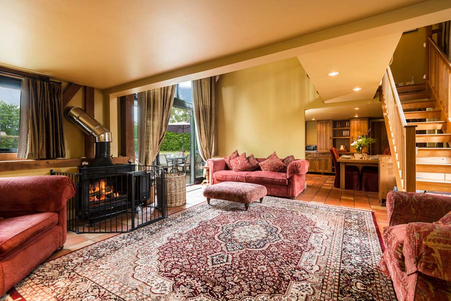 roaring fire in a lounge with stairs