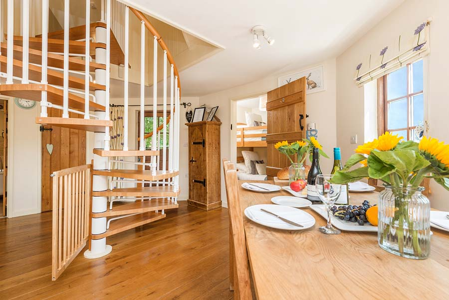 kitchen with stairs and set dining table