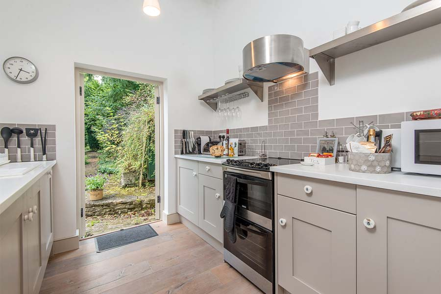 kitchen with back door open to garden