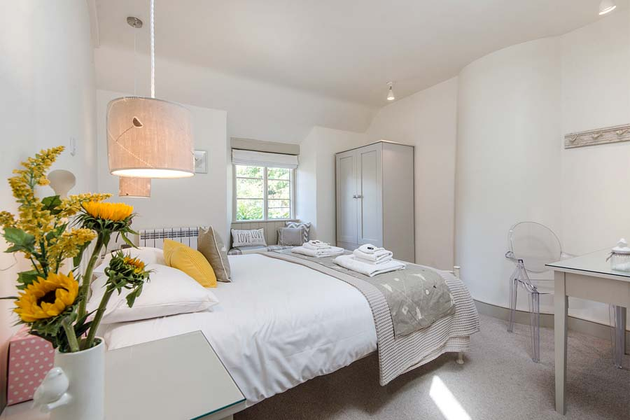 master bedroom with flowers and window
