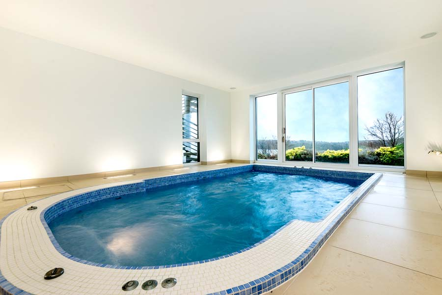 swimming pool and sauna with balcony and sea view