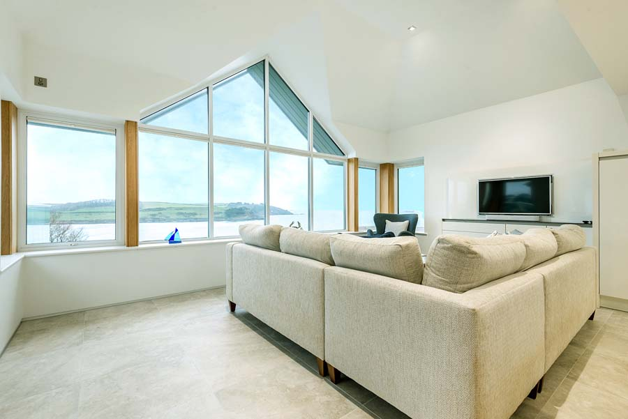 room with sea view, sofa and TV